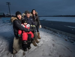 Samantha Frost with her family, Chandel Frost, Landon Hart and Steven Frost, citizens of the Vuntut Gwitchin First Nation, Old Crow, Yukon Territory: Every day we eat fish, every day we eat caribou. Without that, we would feel less from our own land. -