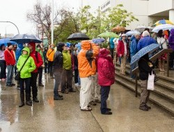 While the Yukon Court of Appeal hears the case, Yukoners gather in the pouring rain for a Water Ceremony.  -